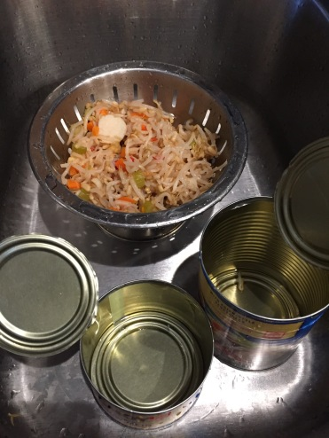 Draining vegetable. Empty cans. All ingredients accounted for.