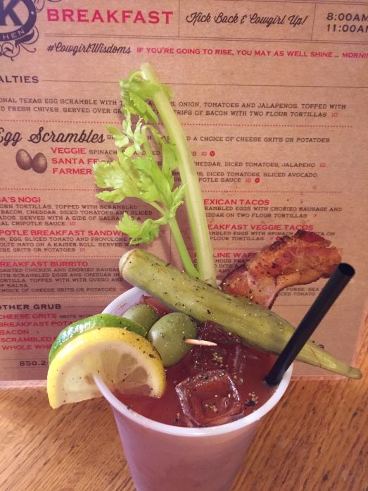 Whole Hog Bloody Mary is fully dressed with Bacon and a hunk of pickled okra.