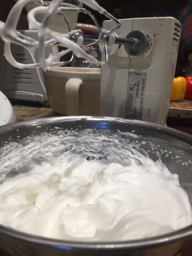 The fussy step of whipping and folding in egg whites.