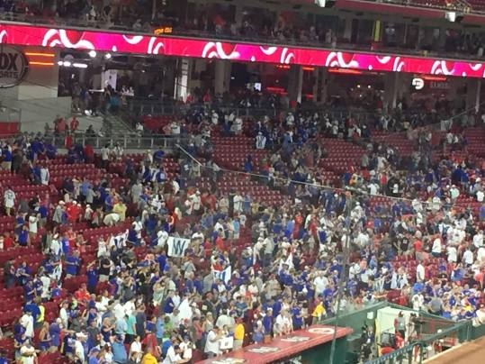 Not a big crowd, but many Cubs fans waving their victory banner.