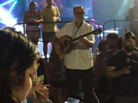 The Bouzouki player steps into the crowd for the free dance.