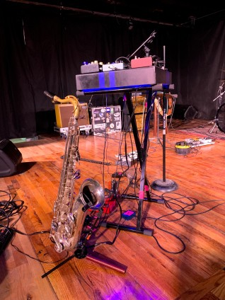 The saxophonist used what I call a wah wah pedal to produce musical loops. I'd not seen a jazz musician use this technique.
