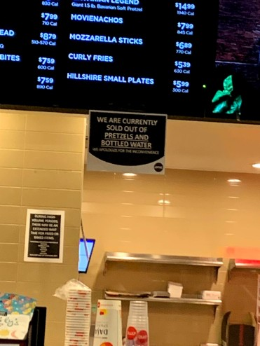 AMC theater run out of water and pretzels so often, they have a sign.